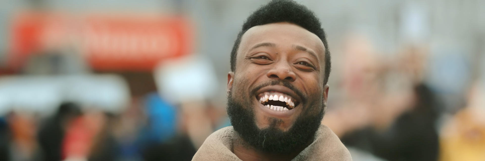 Happy Afro-American man showing nice teeth in his smile.