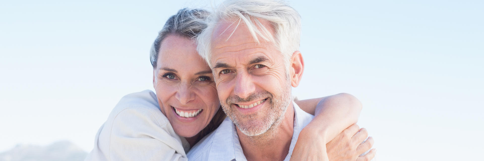 Middle-aged couple with perfect smiles