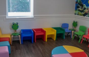 Kids waiting zone with colorful chairs at SmileBuilders, Inc.