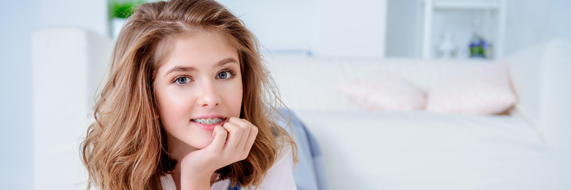 A teenage girl wearing orthodontic braces.