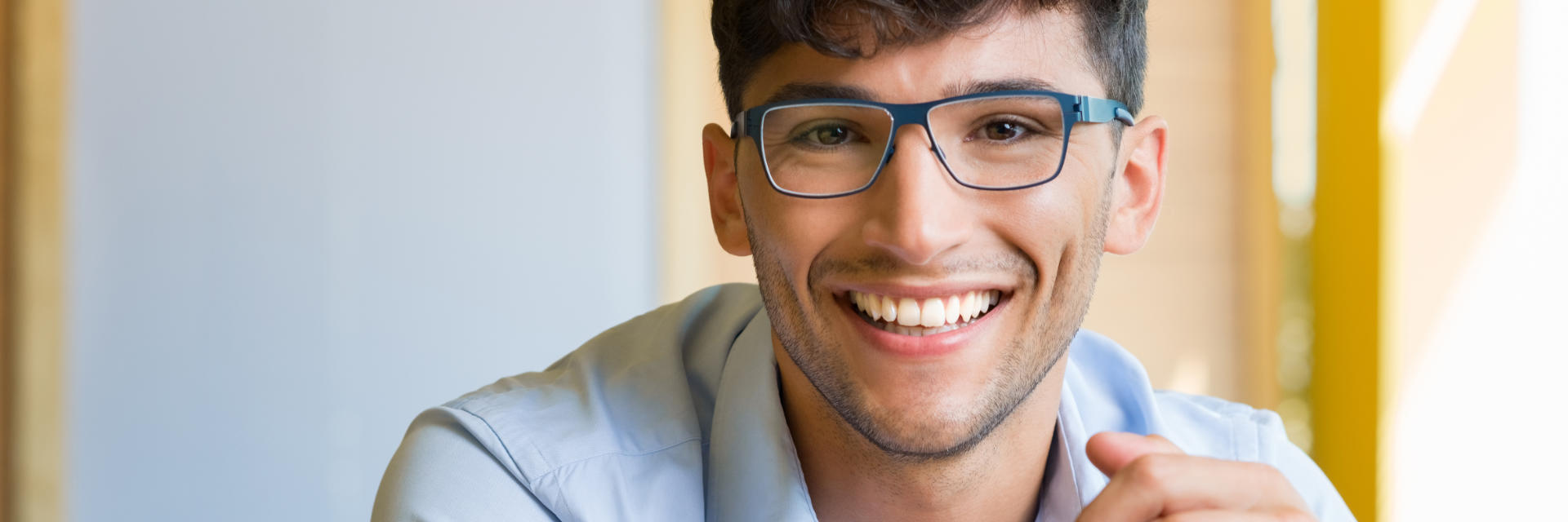 Young man wearing glasses with perfect smile.