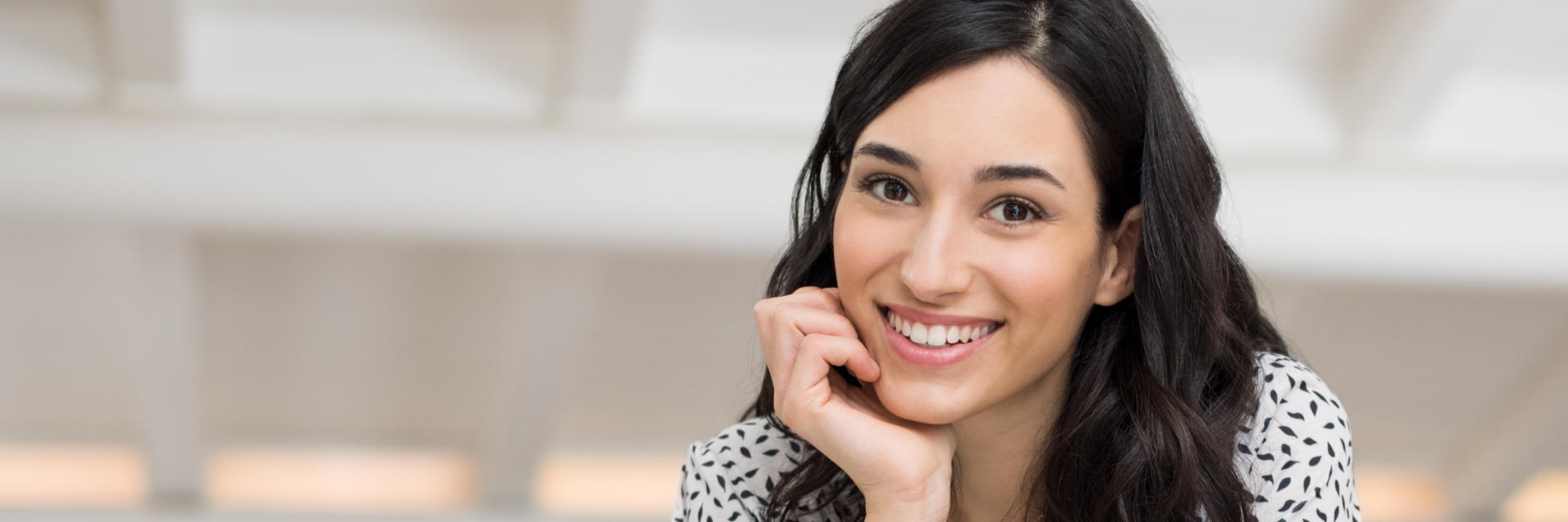 Beautiful young dark-haired woman with perfect smile.